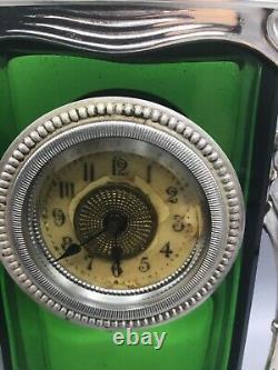 A German Art Nouveau silver plated metal and green glass mantel clock circa 1910