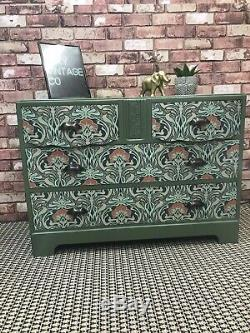 Art Nouveau print and bayberry green sideboard
