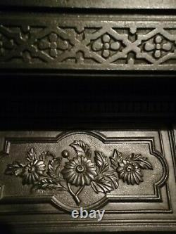 Cast iron tiled fireplace. Great condition. Art Nouveau style tiles in green