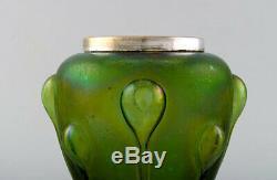 Lötz art nouveau vase in iridescent art glass with silver edge